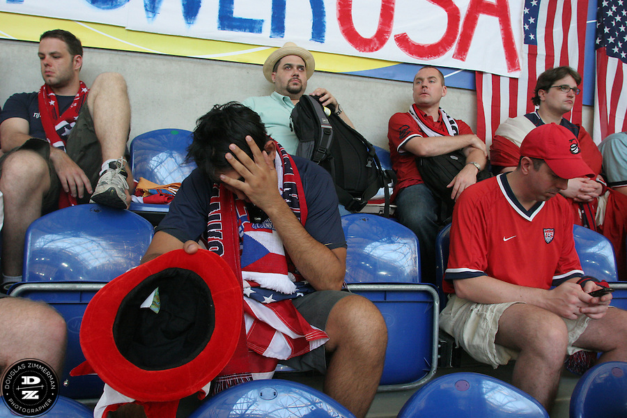 Several USA National Soccer Team fans react and sit in the stands well after the end of the USA's loss in a first round match against the Czech Republic on Monday June 12th, 2006 in Gelsenkirchen, Germany.  The United States lost the match 3-0.