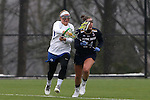 01 March 2015: Duke's Kyra Harney (left) tries to knock the ball away from Notre Dame's Casey Pearsall (24). The Duke University Blue Devils hosted the University of Notre Dame Fighting Irish on the West Turf Field at the Duke Athletic Field Complex in Durham, North Carolina in a 2015 NCAA Division I Women's Lacrosse match. Duke won the game 17-3.