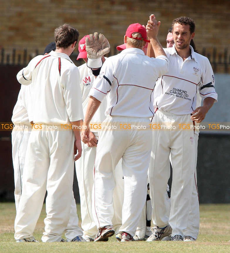 Craig Smith of Hornchurch is congratulated after getting the wicket of Wickford's Chirag Desai - Wickford Cricket Club vs Hornchurch Cricket Club at Wickford - 05/09/09 - MANDATORY CREDIT: Rob Newell/TGSPHOTO - Self billing applies where appropriate - 0845 094 6026 - contact@tgsphoto.co.uk - NO UNPAID USE.