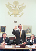 Former Democratic fund raiser John Huang is sworn-in to testify before the United States House Government Operations Committee in Washington, D.C. to answer charges he arranged nearly one million dollars in illegal contributions for the Clinton-Gore re-election campaign in 1996 on December 15, 1999.<br /> Credit: Ron Sachs / CNP