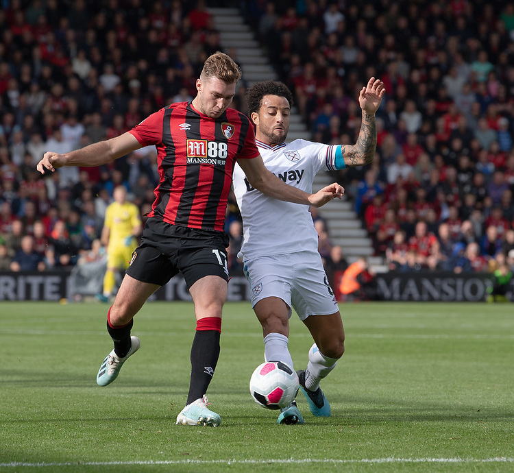 Bournemouth's Jack Stacey (left) battles for possession with West Ham United's Felipe Anderson (right) <br /> <br /> Photographer David Horton/CameraSport<br /> <br /> The Premier League - Bournemouth v West Ham United - Saturday 28th September 2019 - Vitality Stadium - Bournemouth<br /> <br /> World Copyright © 2019 CameraSport. All rights reserved. 43 Linden Ave. Countesthorpe. Leicester. England. LE8 5PG - Tel: +44 (0) 116 277 4147 - admin@camerasport.com - www.camerasport.com
