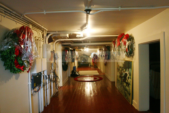 The third floor of Maxwell Place houses mostly Christmas decorations, such as these wreaths that line the hallway.
