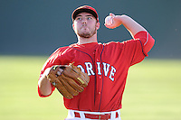 Starting pitcher Daniel McGrath (17) of the Greenville Drive warms up before a game against the Lexington Legends on Sunday, August 31, 2014, at Fluor Field at the West End in Greenville, South Carolina. Greenville won, 3-2. (Tom Priddy/Four Seam Images)