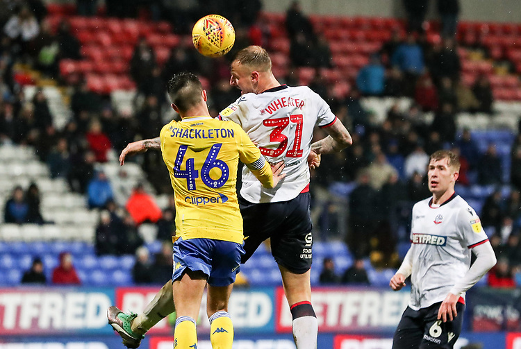 Bolton Wanderers' David Wheater competing with Leeds United's Jamie Shackleton<br /> <br /> Photographer Andrew Kearns/CameraSport<br /> <br /> The EFL Sky Bet Championship - Bolton Wanderers v Leeds United - Saturday 15th December 2018 - University of Bolton Stadium - Bolton<br /> <br /> World Copyright © 2018 CameraSport. All rights reserved. 43 Linden Ave. Countesthorpe. Leicester. England. LE8 5PG - Tel: +44 (0) 116 277 4147 - admin@camerasport.com - www.camerasport.com