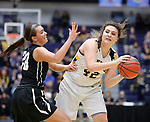 SIOUX FALLS, SD: MARCH 12:  Naomi Rust #42 of Augustana looks around Central Missouri defender Megan Skaggs #20 during the 2018 NCAA Division II Women's Basketball Central Region Championship Monday at the Elmen Center in Sioux Falls, S.D. (Photo by DIck Carlson/Inertia)