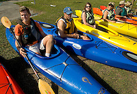 A group of kayak paddlers wait to take off in Amelia Island, FL