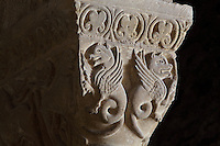 Carved capital depicting 2 winged creatures, to the right of the organ between the ambulatory and the nave of the Abbatiale Sainte-Foy de Conques or Abbey-church of Saint-Foy, Conques, Aveyron, Midi-Pyrenees, France, a Romanesque abbey church begun 1050 under abbot Odolric to house the remains of St Foy, a 4th century female martyr. The church is on the pilgrimage route to Santiago da Compostela, and is listed as a historic monument and a UNESCO World Heritage Site. Picture by Manuel Cohen