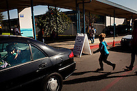 Oceano, California, November 1, 2011 - Parents pick up students at Oceano Elementary School whose student population is a study in contrast. The student body of the district ranges from quite wealthy to close to 90 percent poverty. Many of the areas working class started in the nearby agricultural fields. As a part of an effort to help bridge some of the contrasts in school performance here, the 10,800-student school district of Lucia Mar recently became the first in California to adopt, in four of its schools, the Teacher Advancement Program (TAP) school-reform initiative. The complex model couples professional development, teacher observations keyed to a set of teaching standards and  leadership opportunities for teachers. .