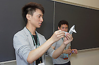OrigamiUSA 2016 Convention at St. John's University, Queens, New York, USA. Kade Chan's teaches his origami design Capricorn to a morning class with Jason Ku's help.
