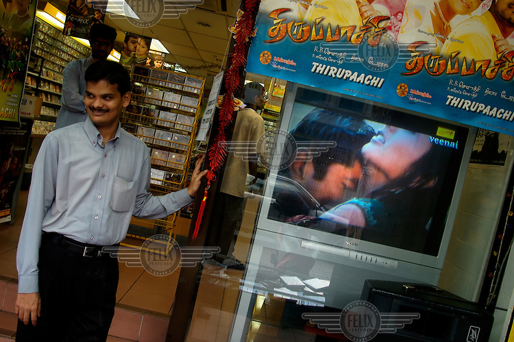 Little India - Indian entertainment store selling imported Bollywood movies with one being played (showing a love scene) on a Sony television in the window.
