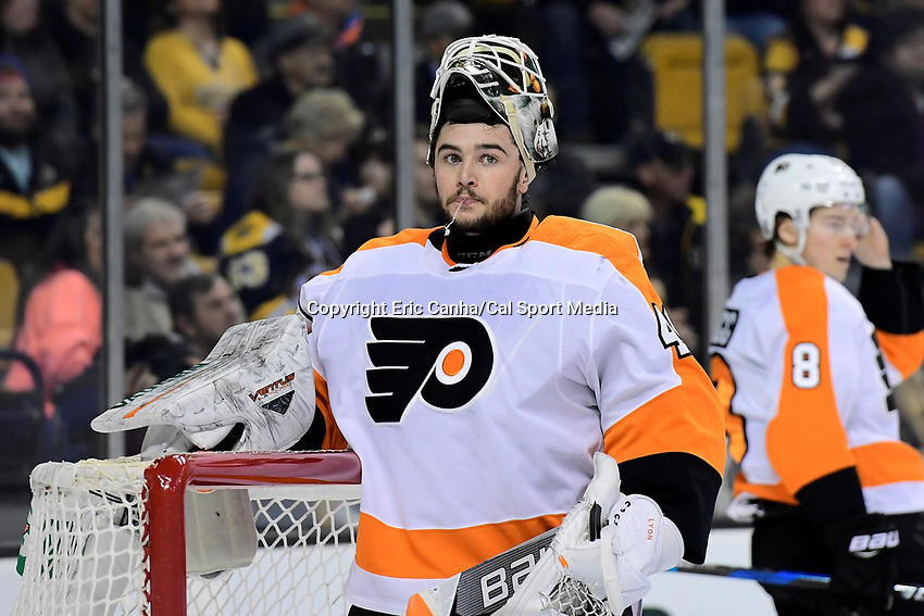 March 8, 2018: Philadelphia Flyers goaltender Alex Lyon (49) spits a stream of water during the NHL game between the Philadelphia Flyers and the Boston Bruins held at TD Garden, in Boston, Mass. Boston defeats Philadelphia 3-2 in regulation time. Eric Canha/CSM