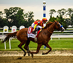 Elmont, NY - JUNE 09: Jockey Mike Smith kisses to give #1, Justify, the go-ahead as they move down the stretch on their way to the finish line for Trainer Bob Baffert during the 150th running of the Belmont Stakes at Belmont Park on June 9, 2018 in Elmont, New York. (Photo by Carson Dennis/Eclipse Sportswire/Getty Images)