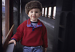Boy in train car with hat