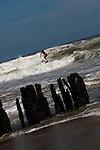 Man surf on large wave.