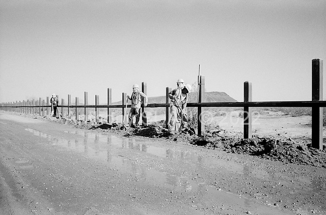 Cabeza Prieta National Wildlife Refuge, Arizona<br /> May 1, 2008<br /> <br /> US contractors place vehicle barrier along the Cabeza Prieta National Wildlife Refuge on the US/Mexican border. New fence and/or vehicle barrier has been placed over the vast majority of the Arizona/Mexican border. This fence has cut illegal crossings substantially in the past 6 months. Many illegal crossings have been pushed eastward to the Tucson sector.