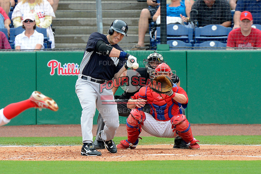 New York Yankees designed hitter Travis Hafner #33 at bat in front of catcher Steven Lerud and umpire David Soucy during a Spring Training game against the Philadelphia Phillies at Bright House Field on February 26, 2013 in Clearwater, Florida.  Philadelphia defeated New York 4-3.  (Mike Janes/Four Seam Images)