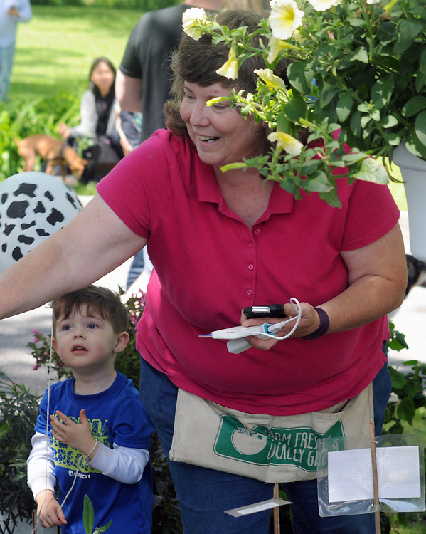 A customer being served at the Nursery Booth at the Opening Day of the 2017 Saugerties Farmer's Market on Saturday, May 27, 2017. Photo by Jim Peppler. Copyright/Jim Peppler-2017.