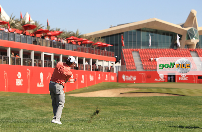 Brett Rumford (AUS) chips into the 18th green during Friday's Round 2 of the Abu Dhabi HSBC Golf Championship at Abu Dhabi Golf Club, 18th January 2013 (Photo Eoin Clarke/www.golffile.ie)