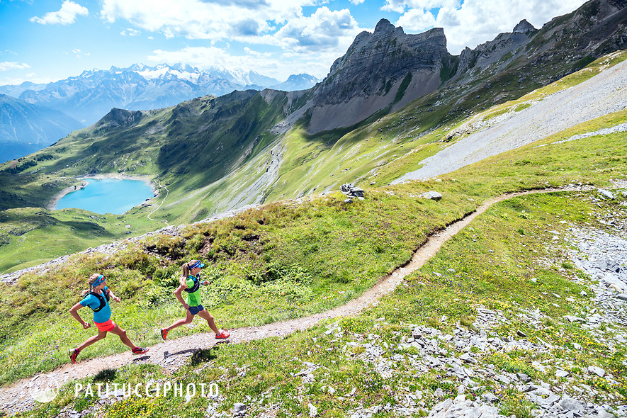 Trail running in the Dent du Morcles area of Switzerland with distant views of Mont Blanc.