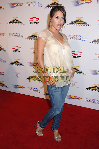 RACHEL STERLING.California Speedway's Running Wide Open at Avalon Hollywood, Hollywood, California, USA..August 29th, 2007.full length jeans denim silver shoes cream sheer top hands in pockets .CAP/ADM/BP.©Byron Purvis/AdMedia/Capital Pictures