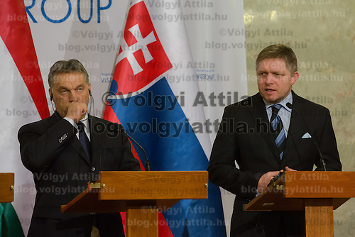 Viktor Orban (L) Prime Minister of Hungary and Robert Fico (R) Prime Minister of Slovakia talk during a press conference after the special meeting of the prime ministers of the Visegrad 4 Group in Budapest, Hungary on January 29, 2014. ATTILA VOLGYI