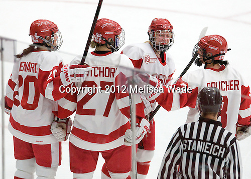 Isabel Menard (BU - 20), Tara Watchorn (BU - 27), Sarah Bayersdorfer (BU - 23), Kasey Boucher (BU - 3) - The Boston University Terriers defeated the Harvard University Crimson 5-2 on Monday, January 31, 2012, in the opening round of the 2012 Women's Beanpot at Walter Brown Arena in Boston, Massachusetts.