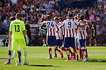 Atletico de Madrid´s players celebrate a goal in front of Espanyol´s goalkeeper Casilla during 2014-15 La Liga Atletico de Madrid V Espanyol match at Vicente Calderon stadium in Madrid, Spain. October 19, 2014. (ALTERPHOTOS/Victor Blanco)