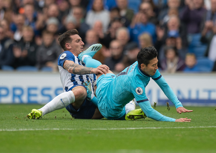 Brighton & Hove Albion's Lewis Dunk's (left) tackled brings down Tottenham Hotspur's Son Heung-Min (right) <br /> <br /> Photographer David Horton/CameraSport<br /> <br /> The Premier League - Brighton and Hove Albion v Tottenham Hotspur - Saturday 5th October 2019 - The Amex Stadium - Brighton<br /> <br /> World Copyright © 2019 CameraSport. All rights reserved. 43 Linden Ave. Countesthorpe. Leicester. England. LE8 5PG - Tel: +44 (0) 116 277 4147 - admin@camerasport.com - www.camerasport.com