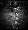Lizard King.  Small boy holding lizard.  Double exposure using Yashica A Twin Lens Reflex and Fuji Neopan 400 film by Liisa Roberts.