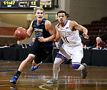 SIOUX FALLS, SD - MARCH 12:  Derek Hinen #34 from St. Francis drives against Talon Pinckney #11 from the College of Idaho during their semifinal game at the 2018 NAIA DII Men's Basketball Championship at the Sanford Pentagon in Sioux Falls. (Photo by Dave Eggen/Inertia)