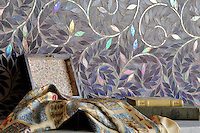 Jacqueline Vine, a handmade mosaic shown in Amethyst jewel glass, is part of the Silk Road Collection by Sara Baldwin for New Ravenna.<br />