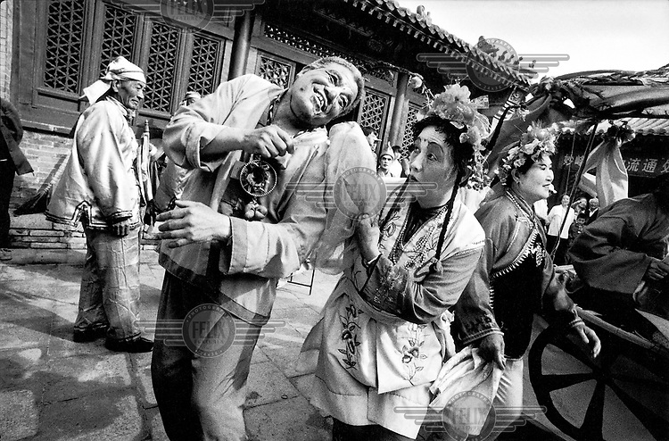 © Rhodri Jones / Panos Pictures..China, Hebei Province. Theatrical troop performing at teh Miaofengshen Temple.