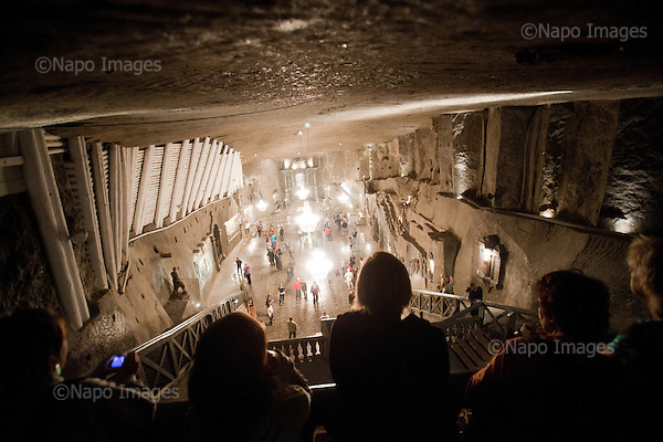 WIELICZKA NEAR KRAKOW, POLAND, SEPTEMBER 12, 2011:.Tourists take a look at Saint Kinga chapel, which was carved and finished 101 meter underground in the Wieliczka salt mine in 1893.  Wieliczka mine is the longest operating single company in the world, part of UNESCO World Heritage..(Photo by Piotr Malecki / Napo Images) ..WIELICZKA, 9/2011:.Kaplica Swietej Kingi.Fot: Piotr Malecki / Napo Images