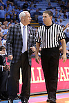 16 November 2014: UNC head coach Roy Williams (left) talks with referee Joe Lindsay (right). The University of North Carolina Tar Heels played the Robert Morris University Colonials in an NCAA Division I Men's basketball game at the Dean E. Smith Center in Chapel Hill, North Carolina. UNC won the game 103-59.