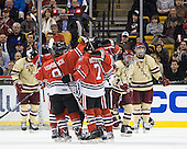Garrett Vermeersch (Northeastern - 9), Vinny Saponari (Northeastern - 74), Anthony Bitetto (Northeastern - 7) and Ludwig Karlsson (Northeastern - 45) celebrate Bitetto's goal. - The Boston College Eagles defeated the Northeastern University Huskies 7-1 in the opening round of the 2012 Beanpot on Monday, February 6, 2012, at TD Garden in Boston, Massachusetts.