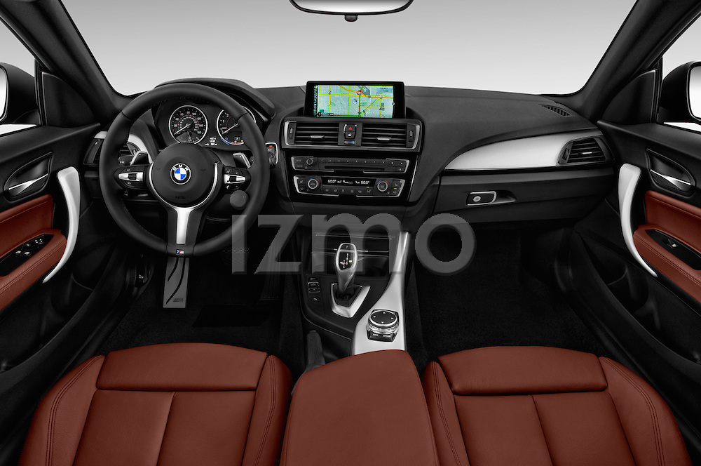 Stock photo of straight dashboard view of 2016 BMW 2 Series M235i 2 Door Coupe Dashboard