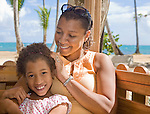 Mother and daughter hug near a beach in Samana Penninsula, Las Terranas, Dominican Republican
