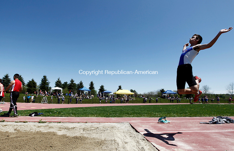 Litchfield, CT- 17 May 2014-051714CM08- Nonnewaug's Matt Albino soars through the air during the long jump at the Berkshire League Track and Field Championships at Litchfield High School on Saturday.    Christopher Massa Republican-American
