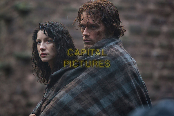 Caitriona Balfe, Sam Heugan<br /> in Outlander (2014) <br /> (Season 1)<br /> *Filmstill - Editorial Use Only*<br /> CAP/FB<br /> Image supplied by Capital Pictures