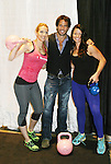 "Days Our Lives Shawn Christian ""Daniel"" poses with the kettlebell and kickboxing girls - Camile Ford (host of Design Wars on HGTV) (just R of Shawn Christian) and Dasha Libin (Marshall Art and Fitness Expert) (L of Shawn) as they are at the 10th Annual Connecticut Women's Expo on September 23, 2012 in Hartford, Connecticut.  (Photo by Sue Coflin/Max Photos)"