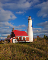 Tawas Point State Park, MI:  Dune grasses and sand path lead to Tawas Point Light (1853) under clearing skies on Tawas Point, Lake Huron - Iosco County