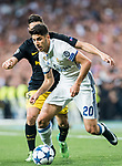 Marco Asensio Willemsen (r) of Real Madrid battles for the ball with Jorge Resurreccion Merodio, Koke, of Atletico de Madrid during their 2016-17 UEFA Champions League Semifinals 1st leg match between Real Madrid and Atletico de Madrid at the Estadio Santiago Bernabeu on 02 May 2017 in Madrid, Spain. Photo by Diego Gonzalez Souto / Power Sport Images