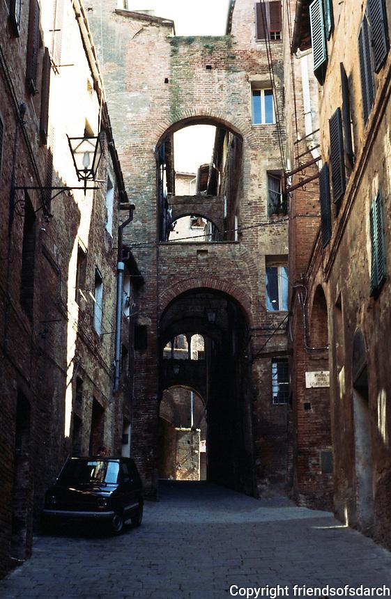 Siena: Arcaded street.