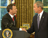 "Washington, D.C. - September 5, 2005 -- Federal Judge John G. Roberts, left, saying he is ""honored and humbled"" shakes hands with President George W. Bush  after he nominated him to succeed Supreme Court Chief Justice William Rehnquist, 5 Septmeber 2005, in the Oval Office. Roberts, who was first nominated to replace retired Justice Sandra Day O'Connor, is to begin confirmation hearings before the Senate Judiciary Committee this week.  .Credit: Mike Theiler - Pool via CNP"