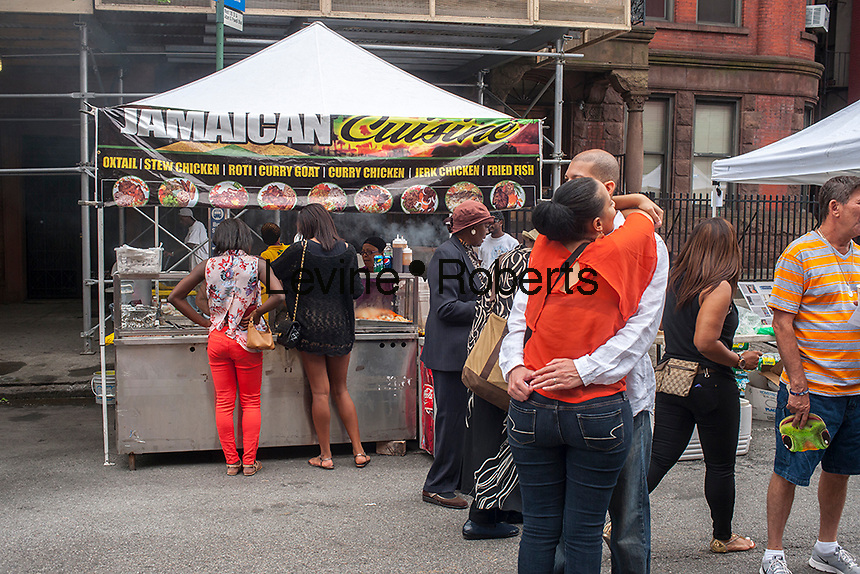 Jamaican cuisine sold at the Harlem Week street fair on West 135th Street in Harlem in New York on Sunday, August 18, 2013. (© Richard B. Levine)