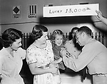 J.D. Chappell, HMC USN, administers an innoculation to Ruth Kennerson while her mother Mrs. Clark Kennerson and Lt. Susan Porzio, USNR, helps to comfort her.