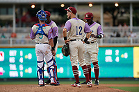 Frisco RoughRiders first baseman Charlie Leblanc (12), catcher Isiah Kiner-Falefa (9), pitcher James Jones (20), and shortstop Michael De Leon (1) during a Texas League game against the Amarillo Sod Poodles on July 13, 2019 at Dr Pepper Ballpark in Frisco, Texas.  (Mike Augustin/Four Seam Images)