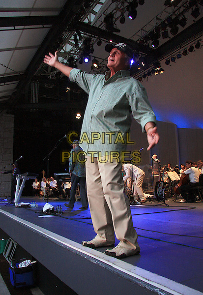 THE BEACH BOYS - Bruce Johnston  .Live in concert at Chastain Park in Georgia, GA, USA, August 13, 2008..concert gig group band music live on stage performing cap hat green shirt full length arms out hands.CAP/ADM/DH.©Dan Harr/AdMedia/Capital Pictures