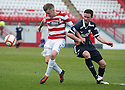 Accies Andy Ryan is pulled back by Raith's Laurie Ellis.