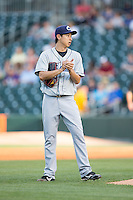 Columbus Clippers starting pitcher Toru Murata (17) rubs up the baseball during the game against the Charlotte Knights at BB&T BallPark on May 27, 2015 in Charlotte, North Carolina.  The Clippers defeated the Knights 9-3.  (Brian Westerholt/Four Seam Images)